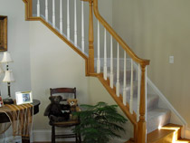 Rake Rail with Box Staircase - Oak Bullnose with Carpet Grade Stairs and Painted Ballusters